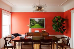 Fascinating-red-white-wall-decor-in-an-elegant-dining-room-furnished-by-wooden-set-and-indoor-plants-also-beautiful-pendant-idea